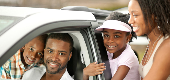 Slideshow Image of a nice family in their new car